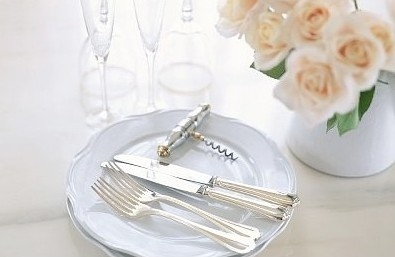 Luxury set of crockery and silver with peach roses