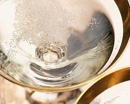champagne in gold rimmed glasses
