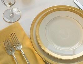 Luxury place setting with gold rimmed plates