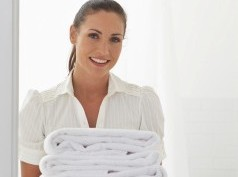 Stewardess, housekeeper with towels