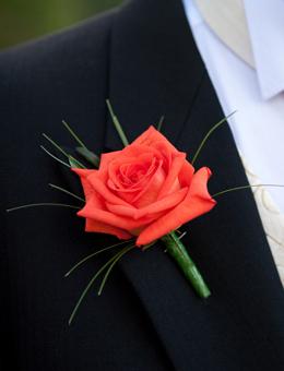 autumn wedding flowers trailing wrist corsage of orange rose petals