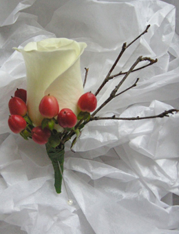 Winter white wedding bouquet with red berries and pine cones