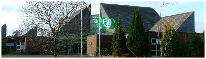 green flag flying over colaiste chiarain