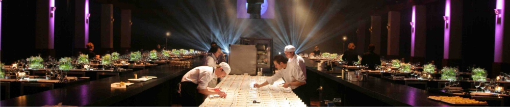 Image of an dinner event, chefs at work