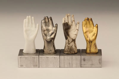 Hands with various finishes, raku, metallic
