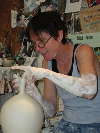 Peggy Loudon working on a wheel thrown vase